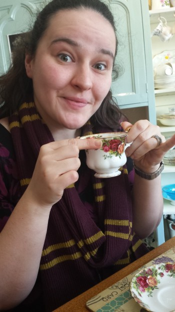 ...Steph enjoying her Earl Grey (and wearing a Gryffindor scarf even though she's a Hufflepuff!)...